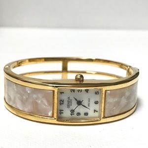 Vintage Geneva Gold Hinged Bangle Watch MOP Dial